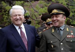 File photo of Russian President Boris Yeltsin and Defence Minister Pavel Grachev sharing a laugh after a wreath laying ceremony at the Tomb of the Unknown Soldier in Moscow